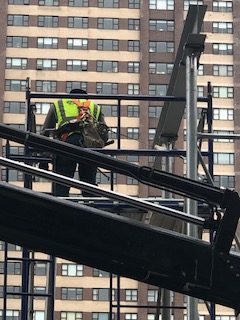 harness safety equipment on scaffold
